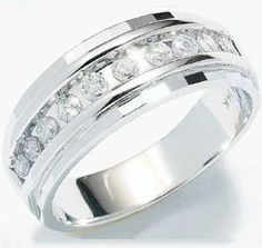 Size - 5.5 - 10k White Gold Classic Channel Set Round Cut Mens Diamond Wedding Ring Band 7mm (1/4 cttw).  List Price: $1,752.00  Savings: $1,123.00 (64%)