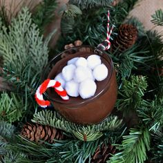 Make a mug of hot cocoa Christmas ornament with just a few basic craft supplies of a cup, paint, cardboard, pom poms and pipe cleaners. Hot Chocolate Gifts, Christmas Hot Chocolate, Christmas Coffee, Christmas Ornaments To Make, Christmas Holidays, Christmas Decorations, Christmas Ideas, Diy Food Gifts, Gag Gifts