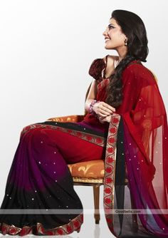 Look fabulous wearing this tri-shaded saree adorned with silver dots. Contrast border gives it partywear look. Best suitable for evening and kitty parties. http://goodbells.com/saree/designer-multicolor-saree-with-silver-dots.html