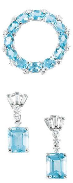 *Aquamarine and Diamond Circle Pin and Pair of Pendant-Earclips, Tiffany & Co. Platinum, white gold, 12 oval aquamarines ap. 7.65 cts., 2 emerald-cut aquamarines ap. 6.30 cts., 24 diamonds ap. 1.45 cts., signed T & Co. & Tiffany & Co., ap. 11.7 dwt