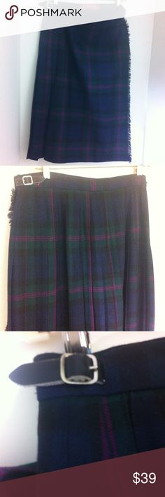 """Stunning Pitlochry Scottish plaid wool skirt. Made in Scotland , tag size 16, pure new wool. Plaid colors are dark blue , dark green, rose and blue. Two black leather adjustable buckles on each side. The flap is fringed and back is box pleated. Gently worn - no rips, tears, holes or stains. Waist 32"""" and can be made 3/4 inch larger or smaller. Length 26 1/4"""" Pitlochry Skirts"""
