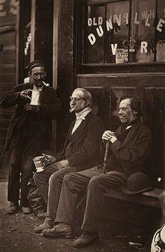 Credit: John Thompson/Alinari via Getty Images Men sit outside a pub circa 1877