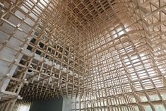 Prostho Museum Research Center by Kengo Kuma and Associates. This building is comprised of a dense orthogonal timber lattice. The interior spaces are carved out from within the wooden matrix.