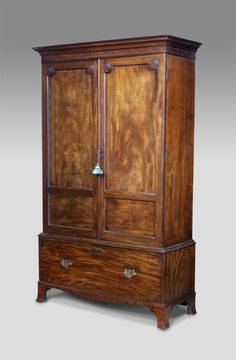 George IV mahogany wardrobe with good colour. Moulded cornice over a pair of flame veneered panel doors with decorative floral paterae. The lower section with a single deep drawer and raised on splayed bracket feet. circa. 1830 £2,450