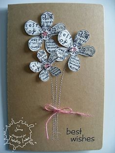 Highly unlikely that I will stitch lines for stems, but I love this idea for making the flowers.