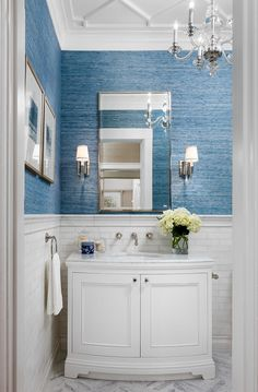Powder room: white marble wainscoting; geometric molding detail on ceiling; custom vanity; Phillip Jeffries Blue Abaca wallcovering; crystal & polished nickel details. Paint and lacquer were Dunn Edwards White Picket Fence. Robert Frank Interiors. Clark Dugger Photography.