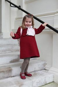 Her Royal Cuteness! Princess Charlotte has started her first day of nursery and to commemorate the big day, Kensington Palace has released an adorable portrait. The photo, which was taken by Charlotte's mother the Duchess of Cambridge, shows the youngster wrapped up in red Amaia kids Razorbil coat and a pink scarf as she smiles …