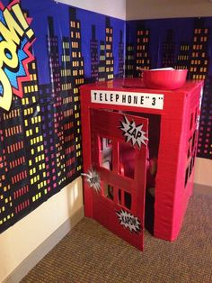 Superhero telephone booth at a boy birthday party!  See more party ideas at CatchMyParty.com!