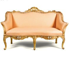 An Italian carved giltwood sofa, Venetian, mid 18th century with a serpentine padded back and sides, the pieced top-rail carved with rocaille and flowers above a serpentine padded seat, pierced seat-rail on five cabriole legs terminating in scrolled feet, the frame carved with flowers, foliage and rocaille on a stippled ground 163cm. wide; 5ft. 4¼in.