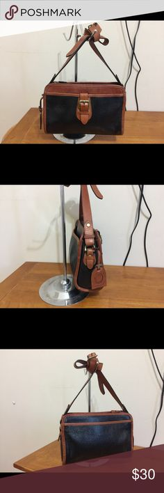 """Black and brown liz Claiborne crossover bag Black and brown liz Claiborne crossover bag  Bag is in good condition no rips however bag does have multiple stains  Measures 10""""W x 8""""H x 2""""D strap drop 24"""" Liz Claiborne Bags Crossbody Bags"""