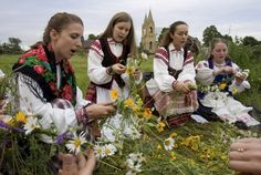Summer Solstice -- I'm not too enthused about the celebration of the summer solstice. It seems a bit pagan. But, I love the folk costumes in this photo.