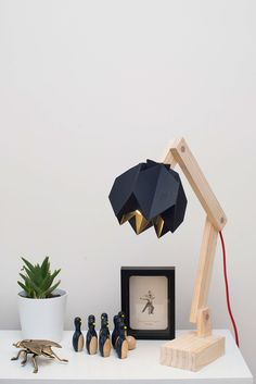 It is a desk lamp and its shape resembles a flower, that's why his name ; hana means flower in Japanese. It is made with paper ( origami ) and wood