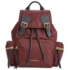 Women's Burberry 'Medium Runway Rucksack' Nylon Backpack (3.990 BRL) ❤ liked on Polyvore featuring bags, backpacks, burgundy red, burgundy backpack, nylon rucksack, water resistant backpack, nylon zipper bag and red backpack