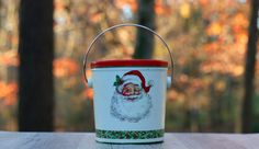A personal favorite from my Etsy shop https://www.etsy.com/listing/257326004/vintage-tin-santa-claus-bucket-potpourri