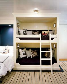 New England Home Magazine  This is the perfect way to sleep a family. Parents in the double, kids in the bunks!