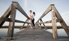 This couple was having a sweet moment on a boardwalk together thinking I was changing my lens when I was really just secretly trying to capture a nice candid moment.
