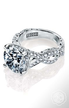 "For the one who loves twists and curves, this ribbon twist ""RoyalT"" engagement ring is calling your name."