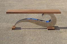 Sculptural metal bench by Chris Bose. Luxury contemporary garden furniture bespoke made.