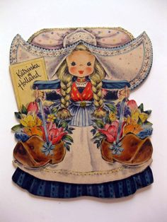 "This little cute paper doll card is part of Hallmark's ""Land of Make Believe"" series. This is Katrinka of Holland Doll #21. She has her story inside along with a 1947 copyright date."