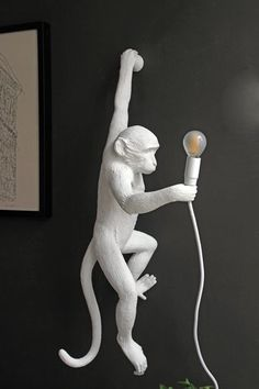 Embrace the kitsch quirkiness of this cute Hanging White Monkey Wall Lamp Crafted from resin and holding an LED bulb this charming monkey will boldy