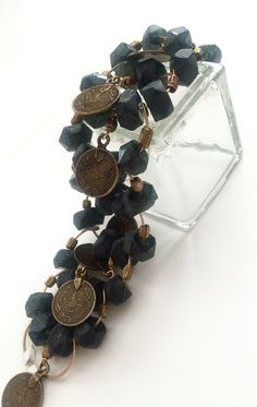 A personal favorite from my Etsy shop https://www.etsy.com/listing/271393259/moroccan-black-and-gold-coin-bracelet