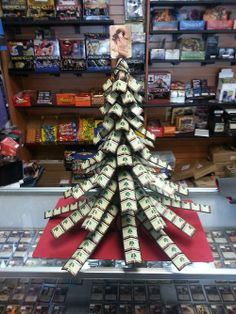 """Magic: The Gathering """"forests"""" cards made a awesome Christmas tree"""