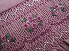 Hand smocked in lovely shades of light to dark rose and ivory. Bullion rose clusters with green leaves intermingled with tiny ivory pearls decorate the smocking Smocking Plates, Smocking Patterns, Sewing Patterns, Embroidery Stitches, Embroidery Patterns, Hand Embroidery, Punto Smok, Smocked Baby Dresses, Smocking Tutorial