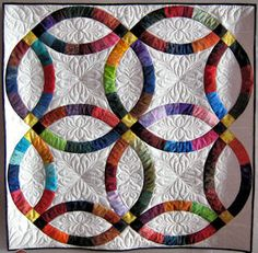 barbara hartman the double wedding ring gained popularity in the and remains one of the most recognized quilt patterns today - Wedding Ring Quilt Pattern