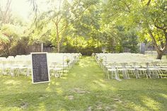 Lovely outdoor location. Like the idea of having the order of the ceremony on a chalkboard rather than programs.