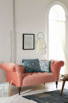 Coral tufted fainting sofa from Urban Outfitters - Decoist