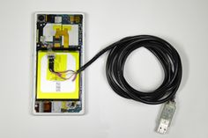 UART adapter connected to an Xperia device.