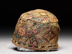 Cap w Triangles & Stars - Egypt› Cairo › Fustat -  10th - 15th century AD  -   silk, embroidered with coloured silk; linen lining; lining sewn with a run-and-fell seam in flax - Dimensions:     11 cm (height) 13.5 cm (diameter) -     ground fabric (linen), along length/width 18 / 18 threads/cm (thread count) - ground fabric (silk) 0.01 cm (thread diam) -  ground fabric (linen) 0.06 cm (thread diam)    additional fibre, embroidery 0.08 cm (thread diam)  silk, linen,