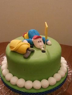 """Golfer topper and accessories on 6"""" sponge chocolate fudge cake"""