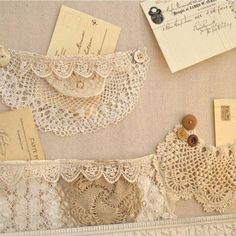 A Shabby Bulletin Board With Pockets Made of Lace And Doily's