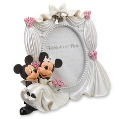 Mickey and Minnie Mouse wedding frame #Disney - I have this! :)  We bought it on our honeymoon!