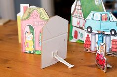 The book also included Busytown buildings to cut out... we adhered them to fiberboard and used a jigsaw to cut out the shapes. glued on some plastic pieces (orginally designed for child-proofing cabinets) so the buildings would be free-standing.