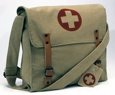 """http://ideasandcouponsforhairdos.com/?qpn-pinnable-post=rothco-battlefield-messenger-medic-bag 12 OZ STONE WASHED CANVAS SIZE: 12 1/2"""" x 11"""" x 3 1/2"""" COLOR CANVAS - KHAKI WITH """"BROWN"""" MEDICS CROSS SYMBOL LARGE COMPARTMENT WITH FLAP BROWN LEATHER CLOSING STRAPS ADJUSTABLE SHOULDER STRAP HANG TAGS"""