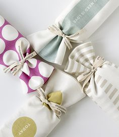 DIY gift wrap idea - gifts wrapped in tea towels - these are pretty