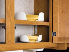 """Stack-a-Plate keeps plates in place during travel to protect them from breakage. Set of 2 includes smaller size for plates up to 7 1/4"""" dia. and larger size for"""