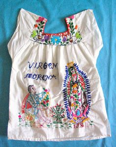 Child's blouse found in Oaxaca City marketplace. The embroidered design shows Saint Juan Diego kneeling before the Virgin of Guadalupe