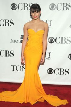 Lea Michele took a chance and looked radiant in a mustard yellow Zac Posen gown.