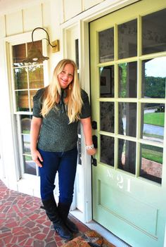 Don't you love this door?  I want to paint my new door eventually.  Also, notice her porch floor.  Looks very familiar!  (House Crashing: Breezy & Bright | Young House Love)
