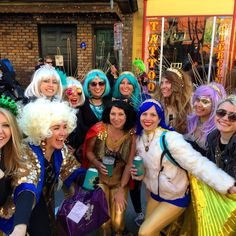 This Mardi Gras Day tops the (king) cake... Krewe of kick ass ladies  headdresses that collide  Big Fun Brass Band  rolling bar cart  Queen Mary wigs galore  #krewedueos #bigfunbrassband #followyournola