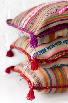 colrful decorative throw pillows made from peruvian textiles | home decor + decorating ideas