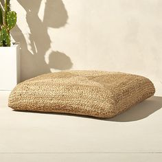 Shop jute floor cushion.   Oversized square fills out the room in coiled braids of natural jute.  Dense poly-fill makes the cushion sturdy for extra seating.  Or, stack two and top with a tray for when guests pop in.