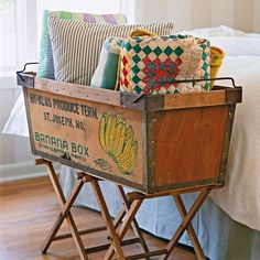 Marry an old fruit crate with two camping stools to create a handy foot-of-the-bed catchall! http://www.bhg.com/decorating/makeovers/furniture/diy-furniture-transformations/?socsrc=bhgpin051015linenbasket&page=14