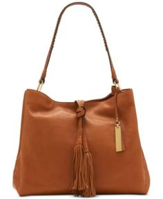 Vince Camuto Taro Hobo $208.50 Now trending. Vince Camuto's Taro hobo organizes personal items in style with a supple leather shape and twin tassels at the front.