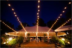 A view of our Sperry Tent with Bistro Lights in the Garden Courtyard - A wedding by Deborah Zoe Photography at the Willowdale Estate in Topsfield, Massachusetts.