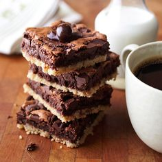 A layer of brownie sandwiched between a crisp sugar cookie crust and melted chocolate pieces.