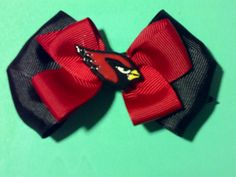 Cardinals inspired double stacked hairbow by LittleRobinsRibbons